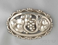Sterling Silver Brooch, Georg Jensen, designed by Georg Jensen, the grape cluster with border design, lg. 2 3/8 in., no. 177A, signed GI and Georg Jensen, Denmark.