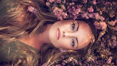 People 1920x1080 model blonde long hair women outdoors looking at viewer lying on back face portrait nature flowers brown eyes sunlight depth of field women