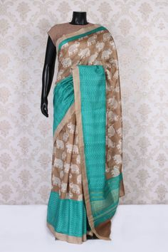 Dark antique #beige and #white tussar silk discerning saree with sea #blue and gold border-SR11050