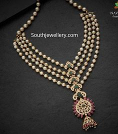 22 carat gold layered south sea pearl necklace with central pendant studded with cz stones, rubies and emeralds by Navrathan jewellers. Pearl Necklace Designs, Gold Pearl Necklace, Jewelry Design Earrings, Gold Jewellery Design, Pearl Jewelry, Diamond Jewelry, Layered Pearl Necklace, Choker Jewelry, Gemstone Earrings