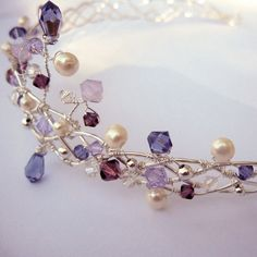 Handmade Swarovski and Pearl tiara.  wind wre round its self again and again to create pleated pattern