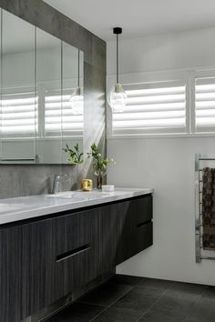 Black and grey modern bathroom with floating vanity and slate tiles. #bathroom #bathroomdesign #modernbathroom #blackbathroom Modern Family, Home And Family, Grey Modern Bathrooms, Slate Tiles, Floating Vanity, Step Inside, New Builds, Sophisticated Style, Black And Grey