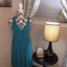 Dress/swimming suit cover up This beautiful teal colored dress I used this as a swimming suit cover up one time and the other time I wore as a sun dress. The breasts are padded so no bra was needed. It's a size large. Poof Dresses Backless