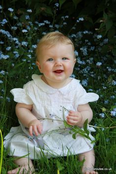 Baby and flowers in May