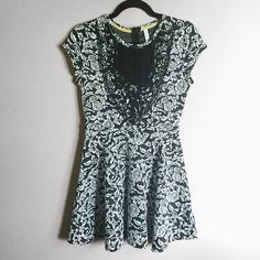 Black and white dress with crochet detailing Very cute black and white skater dress with black crochet detailing in front. Great quality and thick material. Only worn once. ❌ no trades Xhilaration Dresses Mini