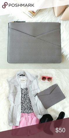 """BANANA REPUBLIC faux leather zip clutch Snakeskin embossed faux leather zip clutch. Pouch pocket on front. Material: 100% synthetic leather. Lining: 100% cotton. Color: taupe grey Measurement approximately: 11.75""""W x 9.25""""H   NWT. Never worn. Can provide more pictures and info upon request. Price firm (use bundle discount for better deal). Banana Republic Bags Clutches & Wristlets"""