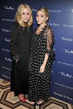 Mary-Kate Olsen (left) in a The Row trench coat and Miu Miu heels and Ashley Olsen in vintage Christian Dior - The Cinema Society's Midnight in Paris screening, May 2011