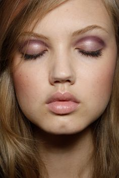 pale lilac eye shadow with a darker shade along the crease, and lip balm
