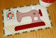 This little mug rug provides the perfect place on my sewing table for my cup and biscuits. Find out more about making mug rugs at the Patchsmith.