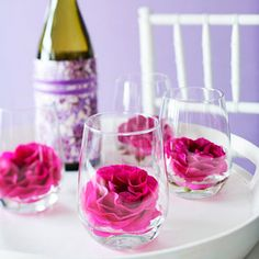 Hot pink spray roses are especially beautiful displayed behind glass. For Mother's Day, float them in stemless wineglasses, using warm water to help the petals open fully. Present with a bottle of wine wrapped in decorative paper