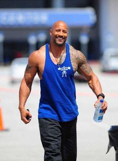 "We don't call him Dwayne ""The Roc"" Johnson for nothing — the man's still got some of the biggest biceps around and a showstopping smile to match."