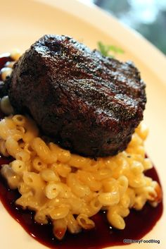 Found in Disney's Animal Kingdom Lodge, at Jiko, the Oak-grilled Filet Mignon with Macaroni and Cheese and Red Wine Sauce is a force to be reckoned with! The macaroni and cheese adds a sharp taste w(Cheese Steak Filet Mignon) Best Disney World Restaurants, Disney World Hotels, Disney World Food, Disney Dishes, Best Steak, Disney Dining, Food Trends, Mac And Cheese, Yummy Food