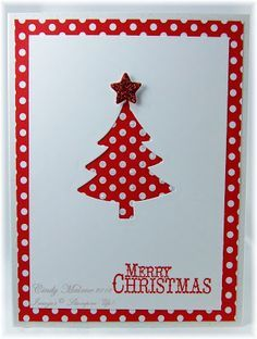 Great use of negative space on this handmade Christmas card.  White card base with a layer of red and white polka dots that shows through the cut out tree.  Red shiny star on top, simple red stamped sentiment.