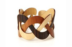 """From Design Milk's series of Uncommon Gifts For Someone Who Has Everything"""" these wooden bracelets/cuffs are made of three different types of wood woven together: Trinity Wooden Cuff by Henry Wischusen, Jewelry Accessories, Fashion Accessories, Jewelry Design, Unique Jewelry, Handmade Jewellery, Jewelry Art, Fashion Jewelry, Women's Fashion, Uncommon Gifts"""