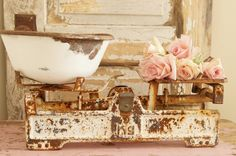 This amazing scale measures approx: 17 inches long x 4 1/2 deep.The rusty heavy bowl is not original to this piece but was added to it, the bowl looks like it was painted slightly.The details and patina is perfect on this scale,which makes this piece a one of a kind.This would look perfect adding a beautiful bouquet of roses in a white ironstone pitcher. Price includes shipping to US only.At this time we do not ship to Alaska or Hawaii.