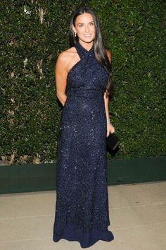 Demi Moore wearing a Ferragamo navy beaded halter gown to the WACPA Inaugural Gala in Beverly Hills.