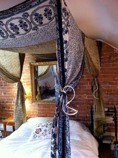 Sari Bed Canopy. Not crazy about the mirror or the brick wall, but oh, that canopy!