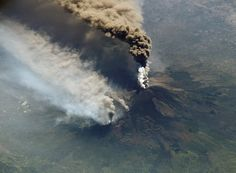 """Mt. Etna. On the 30 oct. 2002 this great image was taken by the ISS. This has been called """"The perfect eruption"""" and lasted a whole year long. To the progressive arise of magmatic material there was also a violent ground deformation and a seismic crisis ended with the Santa Venerina earthquake. A fracture appeared   both on the south side and the north one, with the opening of dozens of new mouths."""