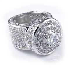 18k White Gold Cluster CZ Iced Out Pinky Ring for Men - Hip Hop Fashion Band by Niv's Bling ,Size 9. ✦HIGH QUALITY - This 18K White Gold Iced Out CZ Micro Pavé ring is made from solid jeweler's brass core and plated with real gold and features a stone count of 231 prong-set CZ stones. ✦SATISFACTION GUARANTEE - Backed by a Lifetime Replacement against all manufacture defects in material and craftsmanship. ✦UNIQUE DESIGN - The innovative prong design allows for the CZ stones to take a new...