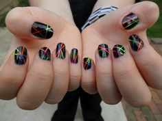 Here's what I did on my daughter's nails when she wanted plain black.  You swipe different bold colors on in whatever pattern you like, let it dry, then apply striping tape in whatever design you choose.  Apply black polish and immediately remove tape.  Let it dry, top coat, and done!