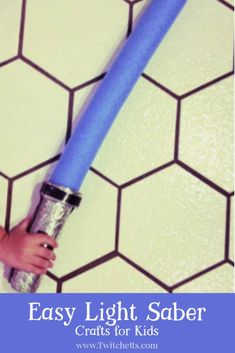 How to make an easy lightsaber using a pool noodle, cardboard and some foil. Great for a Star Wars birthday party. #twitchetts