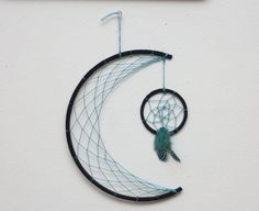 This Boho style dreamcatcher is a 10 crescent moon, fully webbed, with a 3 dreamcatcher dangling like a star beneath it. The hoops are wrapped with Jute and the webbing is a rainbow color changing cotton thread. It puts a different spin on a Native American classic. Other sizes and colors are available upon request. The fourth photo shows a custom black suede moon with teal webbing and feathers. Please leave a message in the note to seller box or message me with the ask seller a question…