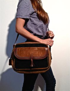 https://www.etsy.com/listing/126925340/cross-body-black-brown-vintage-leather?ref=shop_home_feat