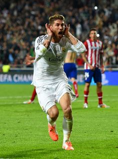 Sergio Ramos celebrates scoring his team's first goal in stoppage time during the UEFA Champions League final match between Real Madrid CF and Club Atlético de Madrid at Estadio Da Luz on May 24, 2014 in Lisbon, Portugal.