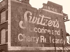 A guy and his camera.... :Switzers Ghost Sign
