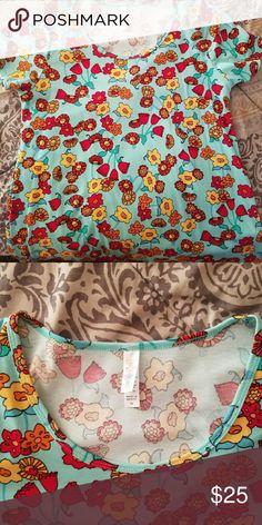 Lularoe Classic Tee with flowers Brand new without tags Classic Tee with flowers LuLaRoe Tops Tees - Short Sleeve