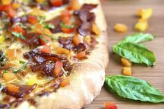 Pesto and Potato Pizza with candied applewood smoked bacon and sweet bell pepper