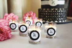 Michaels.com Wedding Department: Monogram Wedding Votives Warm up your table décor with these classy monogrammed candles. Use scrapbook paper, ribbon and cool buttons to create this simple project for your reception. Designed by Michaels Design Team.