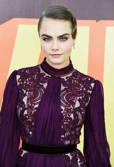 Cara Delevingne paired a purple smoky eye with a vintage victory roll for the MTV Movie Awards.