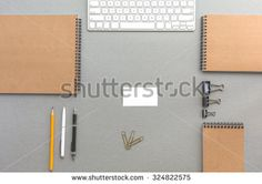 Grey Wooden Desk with Business Items in Calm Classic Colors Mock Up Template of Stationary and Tools in Office Every Day Life Top View Directly from Above with Blank Business Card in Center
