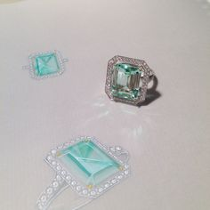 A mint green beryl ring in a diamond Art Deco inspired setting. Pictured next to its original gouache.