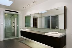 mirrored medicine cabinet Bathroom Contemporary with above counter sink broken glass tile floating