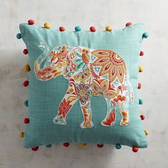 It's trunks up for good luck with this colorful Indian-inspired print with lively pompom detail. Crafted of comfortable cotton, our unforgettable pillow is ready to brighten up any room.