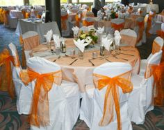 I have 100 white poly/cotton banquet chair covers.  85 have been used once and washed without any stains or signs of wear, 15 are brand new.    I also have 100 tangerine orange chair sashes  10 orange table overlays  10 silver table runners    Selling all or separate.  Chair covers - $150  Chair Sashes - $20  Table Overlays - $10  Tablle Runners - $10    Take everything for $175