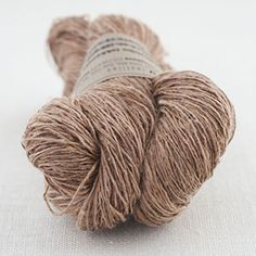 [][][] A-15. Kakishibu Tokkenshi. Colour: 41 persimmon. Silk dyed with natural dyes (persimmon tannin, bengara, sumi charcoal) Good warp yarn. Softens greatly after handling. $13.50 100% silk 155 yds. lace weight. US1-5.