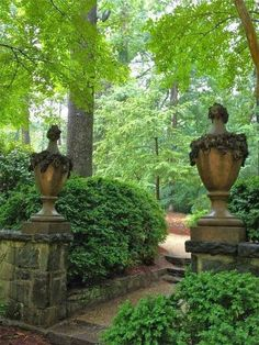 WHAT BEAUTIFUL URNS! Imagine walking down a path in the woods and suddenly coming across a few stone steps, flanked by these huge, bronze urns!   ........Wonder where they lead??? =) A