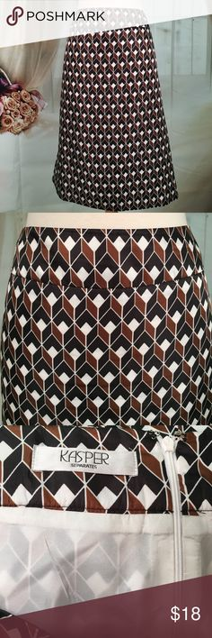 Kasper Black & Brown Business Skirt Great business skirt! 100% polyester. Fully lined. Zipper in the back. New condition. Size 18.  Waist measured flat 20 inches in length 24 1/2 inches.  SK167 LOC-7 Kasper Skirts