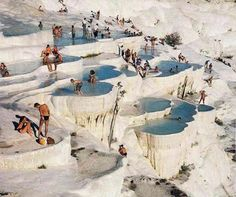 """The Incredible Terraced Chalk Ponds of Pamukkale """"What looks like a winter wonderland is actually a summer landscape with hot springs, crusted with calcium deposits. Pamukkale, in south western. Pamukkale, Oh The Places You'll Go, Places To Travel, Places To Visit, Voyager C'est Vivre, Beautiful World, Beautiful Places, Thermal Pool, Thermal Baths"""