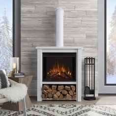 Hollis Electric Fireplace in White by Real Flame - Real Flame suited for many environments, the Hollis Electric Fireplace is designed to replicate the look of a built-in wood stove. A compact footprint allows practically endless placement Contemporary Electric Fireplace, White Electric Fireplace, Electric Fireplaces, Indoor Fireplaces, Electric Wood Stove, Electric Fires, Electric Fireplace Heater, Contemporary Cabin, Modern Fireplaces
