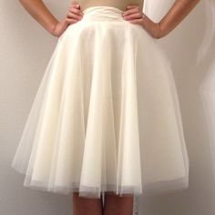 """Tulle skirt Cool handmade tulle skirt. Features a fully lined full midi circle skirt with a side zipper! Very cute skirt it glimmers in the light and the sheer layers make the whimsical feeling skirt very fun flirty and fantastically beautiful to wear! Measures: 29"""" waist 24"""" length Mimi Cariño Skirts Midi"""