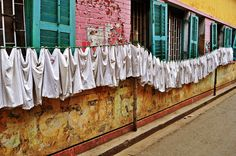 Laundry drying on the streets of Kolkata | Smelly Laundry? | Washer Odor? | http://WasherFan.com | Permanently Eliminate or Prevent Washer & Laundry Odor with Washer Fan™ Breeze™ | #Laundry #WasherOdor #SWS