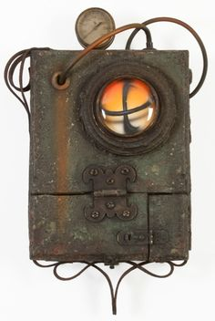 """Jason Brammer Time Machine LXI Acrylic, Plaster, Antique Hardware, Salvaged Leather, Cable, Velvet, and Metal on Wood, 2010   (Note that the two hinged doors on the bottom of the piece open to reveal more hidden artwork inside a recessed chamber).  Size (H x W x D): 18"""" x 11.5"""" x 4.5"""" (total size, including attachments)"""