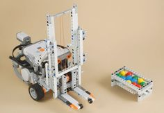 Fork Lift.  Our FLL team built a really cook forklift one year that was similar to this.