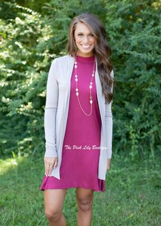 Cardigan layered over a dress with a statement necklace. An easy and comfy look for fall!