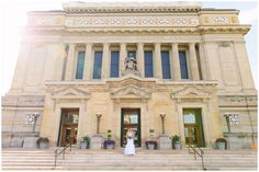 Wide angle wedding photo of bride and groom in front of Soldiers and Sailors Museum in Pittsburgh PA