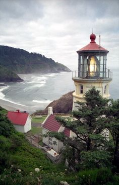 Heceta Head Light near Florence, Oregon. The tower is 56 feet tall with a focal plane of 205 feet above sea level. The most powerful light along the Oregon coast, the light can be seen 21 miles out to sea and is only stopped by the curvature of the earth. Magic Places, Lighthouse Pictures, Lighthouse Art, Photo Images, Beacon Of Light, Oregon Coast, Oregon Usa, Parcs, Le Moulin